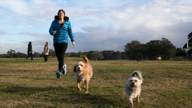 Camille Gray, Rose Donnelly and Robyn Gilbert with their dogs in Astrolabe Park.