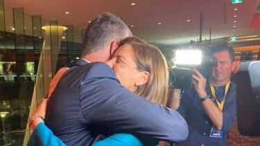 Ms Frecklington embraces her deputy Tim Mander following her concession speech.