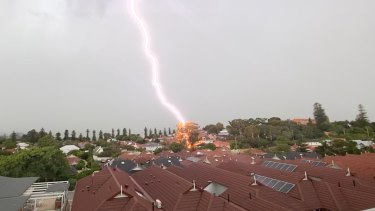 "Steven Overmeire took this shot in Wembley about 5pm. ""I took this from the balcony of my parents' apartment in Mercy Retirement Village, Wembley just at the time (around 5pm) this lightning struck a tree, which caught fire. DFES were quick on the scene and luckily no one hurt, just a few damaged branches of a large gum tree."""