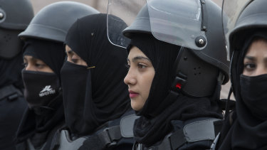 Pakistani police officers stand guard during a rally for International Women's Day in Islamabad, Pakistan.