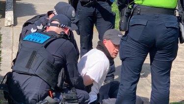 A man is arrested near Elwood Beach on Saturday