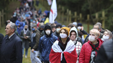 People go to the Kuropaty mass grave site of Soviet-era mass executions during an opposition rally to protest the official presidential election results in Minsk, Belarus.