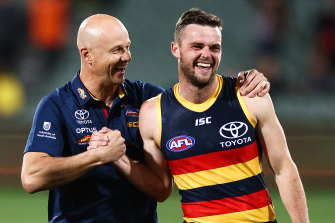 Crows midfielder Brad Crouch (right) with coach Matthew Nicks after the win over the Giants.