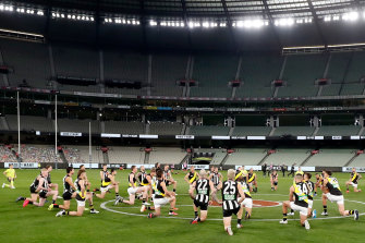 Taking the knee, as Collingwood and Richmond did at this AFL game in June, has become so commonplace that not taking it is now arguably the more overtly political gesture.