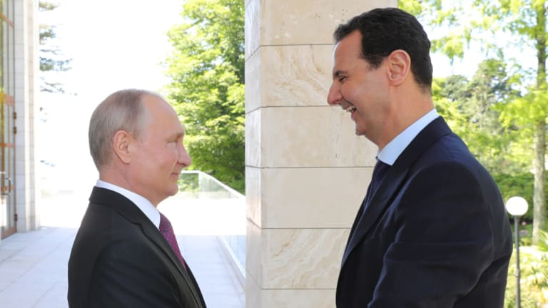 Assad meets with Russian President Vladimir Putin in Sochi, Russia, in May.