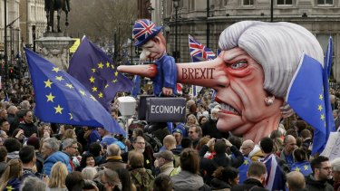 An effigy of British Prime Minister Theresa May is wheeled through Trafalgar Square during a people's vote anti-Brexit march in London.