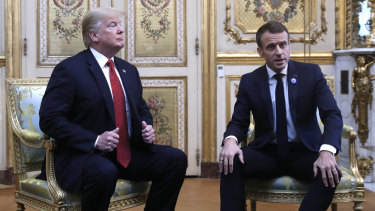 President Donald Trump meets with French President Emmanuel Macron inside the Elysee Palace.