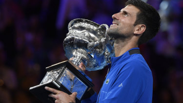 Higher vision: Djokovic holds up the Australian Open trophy.