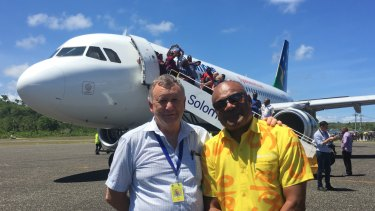 Solomon Airlines chief executive Brett Gebers and Tourism Solomons chief executive Josefa Tuamoto on the tarmac in Munda.