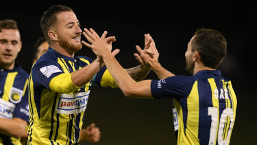 New faces: Ross McCormack  (left) celebrates with Tommy Oar during a pre-season outing for the Mariners.