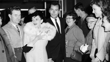 Miss Garland and her entourage leaving the Southern Cross Hotel.