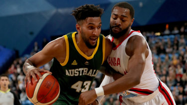 Boomer Jonah Bolden drives past Duane Notice during the first Australia v Canada match at RAC Arena in Perth.