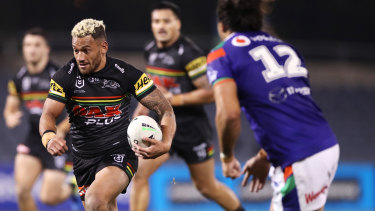 Apisai Koroisau runs the ball for Penrith during their last meeting with the Warriors in June.