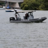 Water police boats and divers returned to the Brisbane River on Monday to search for Matt Jarvis.