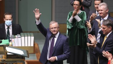 Opposition Leader Anthony Albanese is applauded by colleagues after delivering the budget reply in the House of Representatives on Thursday.