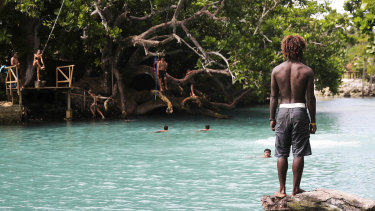 People swimming at Blue Lagoon on Efate island in Vanuatu.