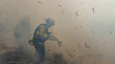 Firefighters work to extinguish flames from the Kincade Fire in Sonoma County, California on Sunday, October 27.