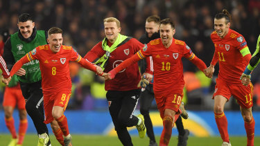 Harry Wilson, Ramsey and Gareth Bale react after securing direct qualification.