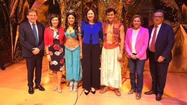 The announcement was held on the Aladdin stage. Left to right: Queensland Performing Arts Trust chairman Professor Peter Coaldrake, Arts Minister Leeanne Enoch, Aladdin's Princess Jasmine (Shubshri Kandiah), Premier Annastacia Palaszczuk, Aladdin (Ainsley Melham), Deputy Premier Jackie Trad, QPAC chief executive John Kotzas.