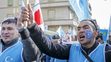 Uyghurs demonstrate against China during the Universal Periodic Review of China by the Human Rights Council in Geneva, Switzerland.