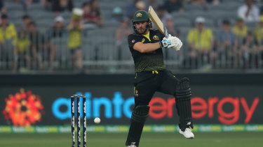 Half-ton: Aaron Finch hits out for Australia.