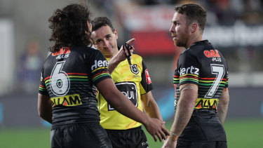 Gerard Sutton sends Jarome Luai (left) to the sin bin during Penrith's golden-point win in Auckland.