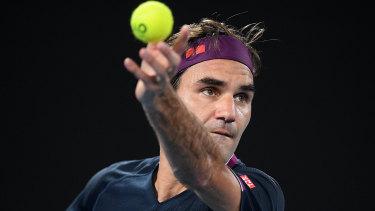 Roger Federer serves during his second round match against Filip Krajinovic of Serbia.
