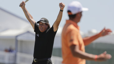 Phil Mickelson sinks his put in his return to the 13th on the final round.