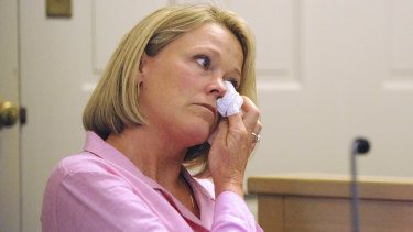 Heather Unruh, a former Boston TV news anchor and the accuser's mother, wipes away tears at the start of her testimony in Nantucket District Court Monday, July 8, 2019.