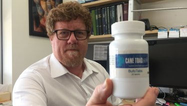 Professor Rob Capon from University of Queensland's Institute of Molecular Bioscience, with his bottled cane toad baits.
