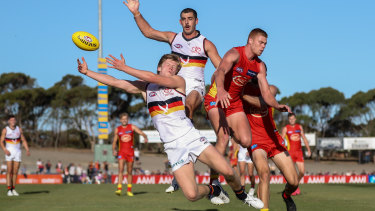 Peter Wright (right) in action for the Suns