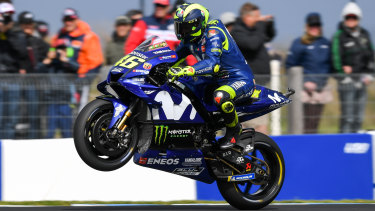 Valentino Rossi pops a mono for the fans at the Island.