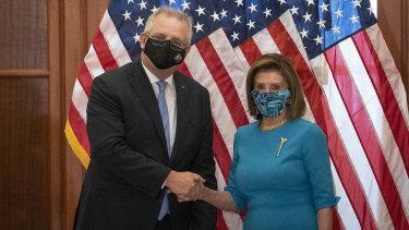 Australian Prime Minister Scott Morrison, left, shakes hands with US House Speaker Nancy Pelosi.