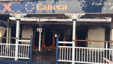 The fire started at the back of Caneca Espresso & Bar and quickly spread, according to firefighters.