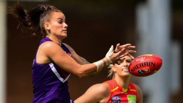 Gemma Houghton of the Dockers rises for a mark.