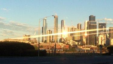 Building glare on the Melbourne skyline skyscrapers.