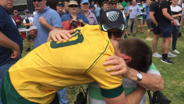 Harrison and his grandfather hug it out after a Junior Wallabies match.