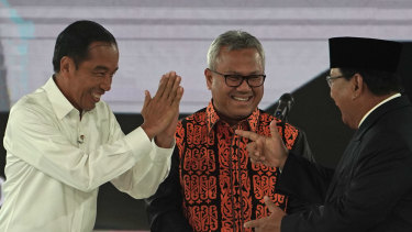 Joko Widodo, Indonesia's president, left, greets Prabowo Subianto, presidential candidate, right, on stage during a fourth presidential debate in Jakarta, Indonesia, on Saturday, March 30.