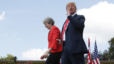 President Donald Trump responds to a reporter's shouted questions as he walks with British Prime Minister Theresa May at the conclusion of their joint news conference at Chequers.
