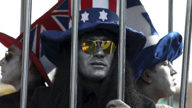 Actors wearing hats in the colours of the flags of Britain, the US and Israel are imprisoned in a cage outside the former US embassy in Tehran.