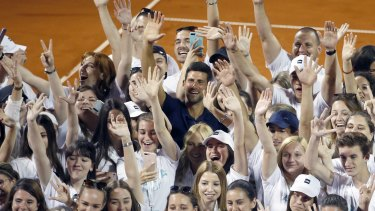 Serbia's Novak Djokovic, centre, poses with volunteers and players after the tournament in Belgrade on June 14.