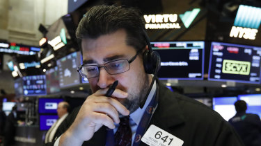 Wall Street is lower but still hovering near record highs on Wednesday.