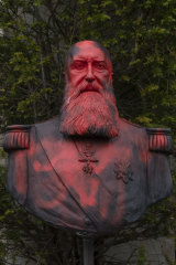 A bust of Belgium's King Leopold II is smeared with red paint and graffiti in Belgium.