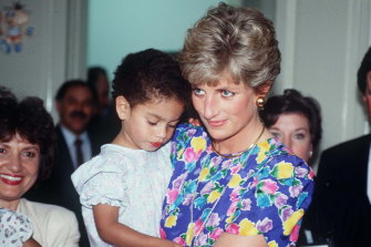 """Princess Diana, wears a favourite """"caring dress"""" during a visit to a hostel caring for children with HIV in Sao Paulo, Brazil."""