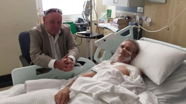 Paul Roberts visits his brother John in the Royal Melbourne Hospital on Tuesday.