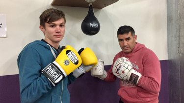 Yass teenager Adriaan Roodt, left, with boxing coach Spider. Adriaan, a student at Campbell High, was tragically killed in an accident on Mount Ainslie.