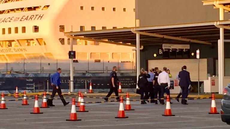 Investigators enter the cruise ship terminal at Hamilton on Sunday.