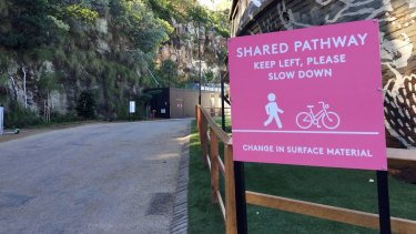 Large signs dotted throughout the Howard Smith Wharves precinct urge visitors to slow down and keep left.