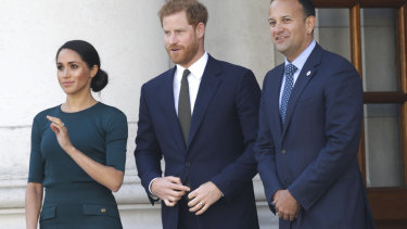 Meghan Markle wears a dark green Givenchy dress to visit the Prime Minister of Ireland's office.