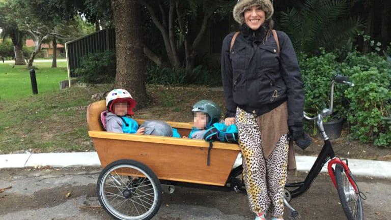Danielle Loizou-Lake with her girls in her $8000 custom-design tricycle.